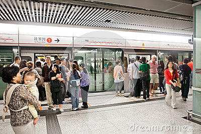 People waiting for train in Hong Kong underground