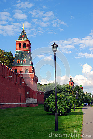 People walk along the Moscow Kremlin in summer Editorial Stock Image