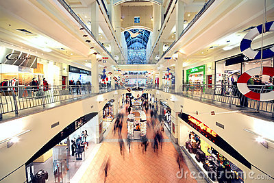People walk in Atrium Mall Editorial Stock Photo