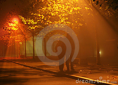 People walk in fog and light
