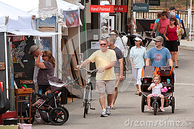 People Walk, Look And Shop At Summer Arts Festival Editorial Stock Image