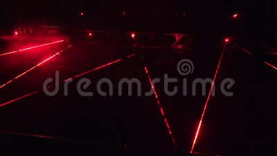 People walk red laser beams at security alarm system demonstration at  night  4K