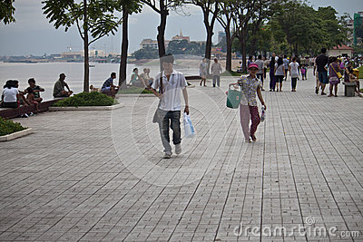 People walk at riverbank Editorial Image