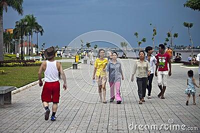 People walk at riverbank Editorial Photography