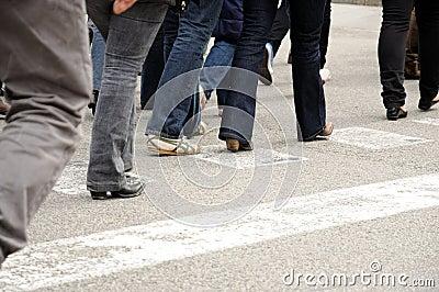 People walking across the street