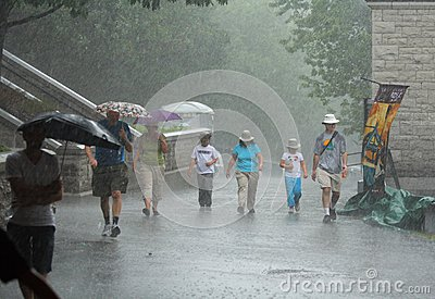 People Walking in Hard Rain Editorial Image