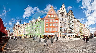 People walking on Main Market Square in Wroclaw.