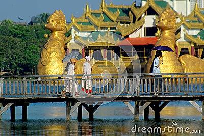 People walking over wooden bridge