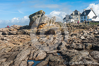 People walking on the stone seashore Editorial Image