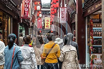 People walking in street of Fang Bang Zhong Lu old city shanghai Editorial Stock Image