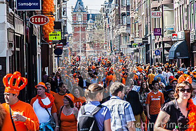 People walking in the streets - Koninginnedag 2012 Editorial Stock Photo