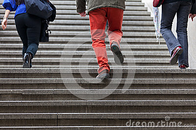 People walking up steps