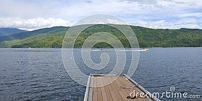 People Water Sking on the Mountain Lake