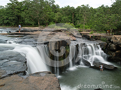 People at a waterfall in Thailand Editorial Stock Image