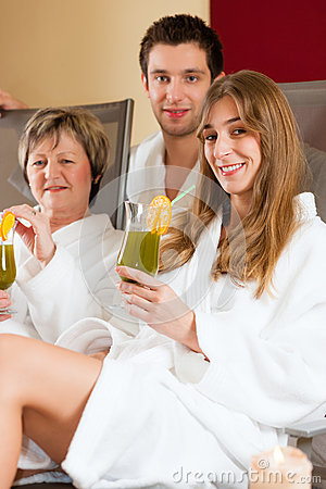 Wellness - People in Spa with Chlorophyll-Shake