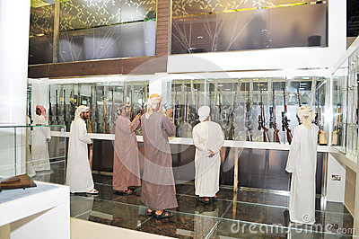 Peoples checking Guns at Abu Dhabi International Hunting and Equestrian Exhibition 2013 Editorial Photo