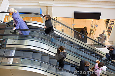 Peoples on escalators in a mall