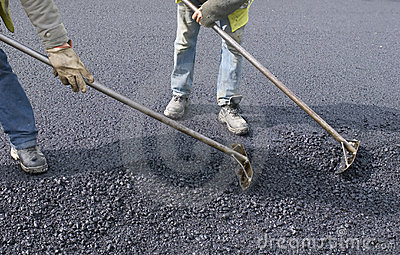 Peoples labor for paving