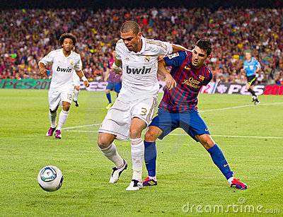 Pepe and David Villa in action Editorial Stock Photo