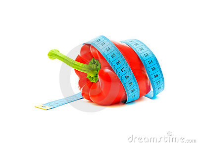 Pepper and a measuring tape on white background Stock Photo