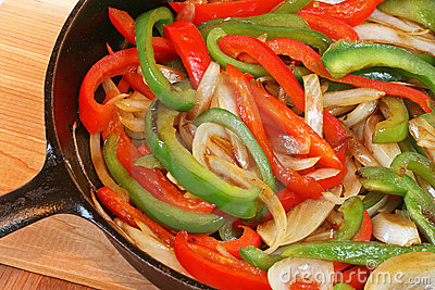 Peppers and onions in black cast iron skillet