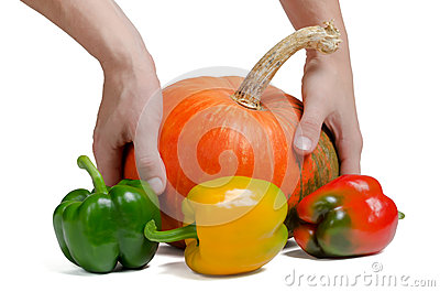Peppers and pumpkin on a white background
