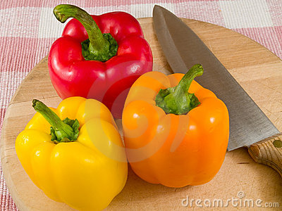 Peppers on a Wooden Cutting Board with Knife