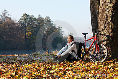Peppy woman cyclist enjoy the recreation in nature