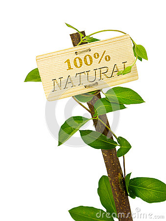 100 percent natural sign message on a wooden panel and green pla