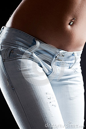 Perfect Abdomen Of A Woman In Blue Jeans