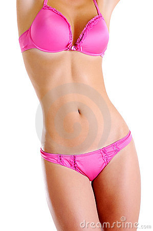 Perfect beautiful nude female body in a pink lingerie front view on