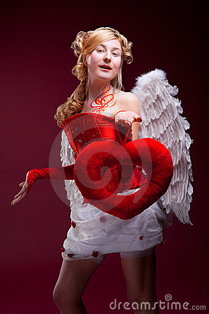 Perfect blonde angel with a red heart