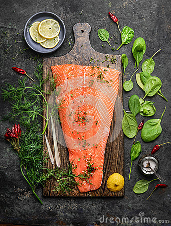 Free Perfect Salmon Fillet On Rustic Cutting Board With Fresh Ingredients For Tasty Cooking Royalty Free Stock Images - 62141069