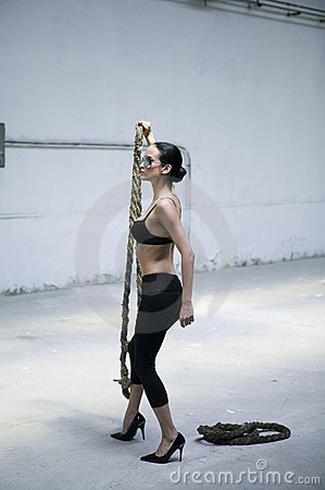 Perfect woman keeping a heavy rope