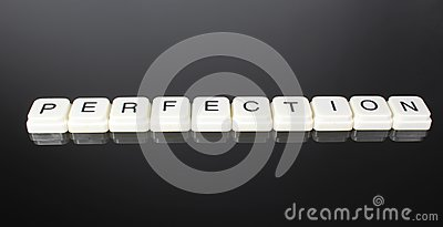Perfection text word title caption label cover backdrop background. Alphabet letter toy blocks on black reflective background. Whi Stock Photo
