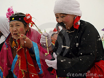 Perform traditional dance Yangge in the snow Editorial Stock Photo