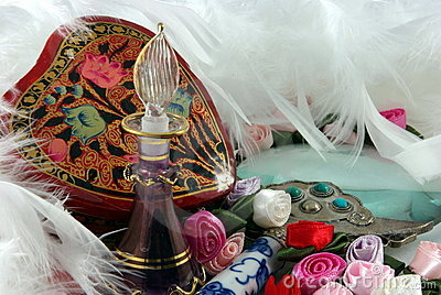 Perfume Bottle, Flowers And Feathers Stock Photography - Image: 4951922