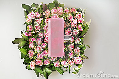 Perfume bottle and roses