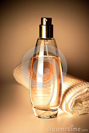 Perfume bottle and towel
