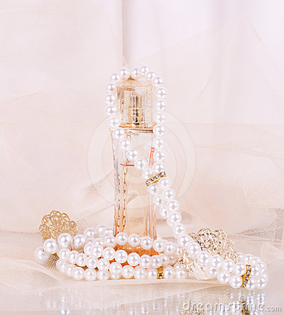 Free Perfume Bottles, Pearls Beads Stock Photos - 24438793