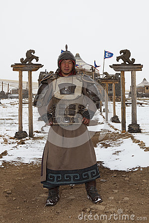 Period dressed Mongolian warrior in front of Ger Editorial Photography