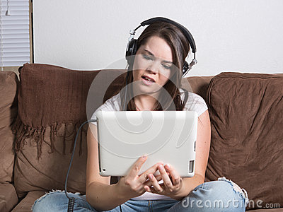 Perplexed woman watching streaming media on tablet