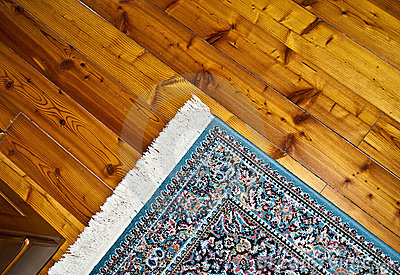 Persian carpet on a wooden floor