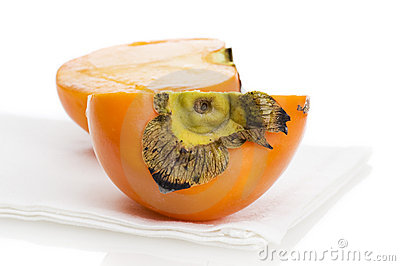 Persimmon on placemat isolated