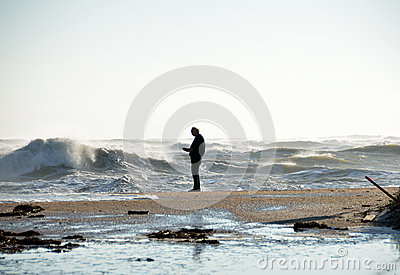 Person on the beach during a storm Editorial Photography