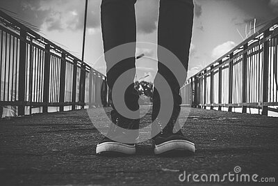 Person In Black Skinny Jeans Standing At The Center Of Road Free Public Domain Cc0 Image