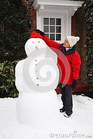 Person building snowman