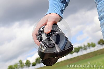 Person Carrying Digital Camera Outdoors Free Public Domain Cc0 Image
