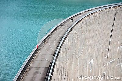 Person on concrete dam