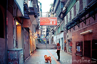 Person with dog walking in Macau Editorial Photography